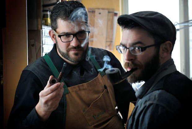 Nick Pancheau and Sean Thomas enjoy a smoke