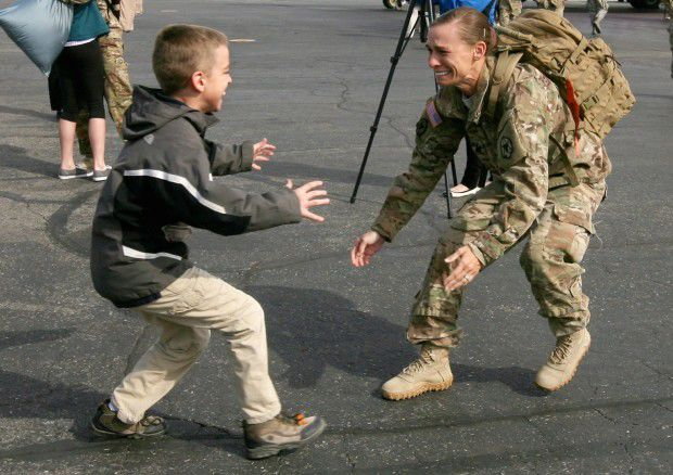 Katie Hornung runs to greet one of her twin sons