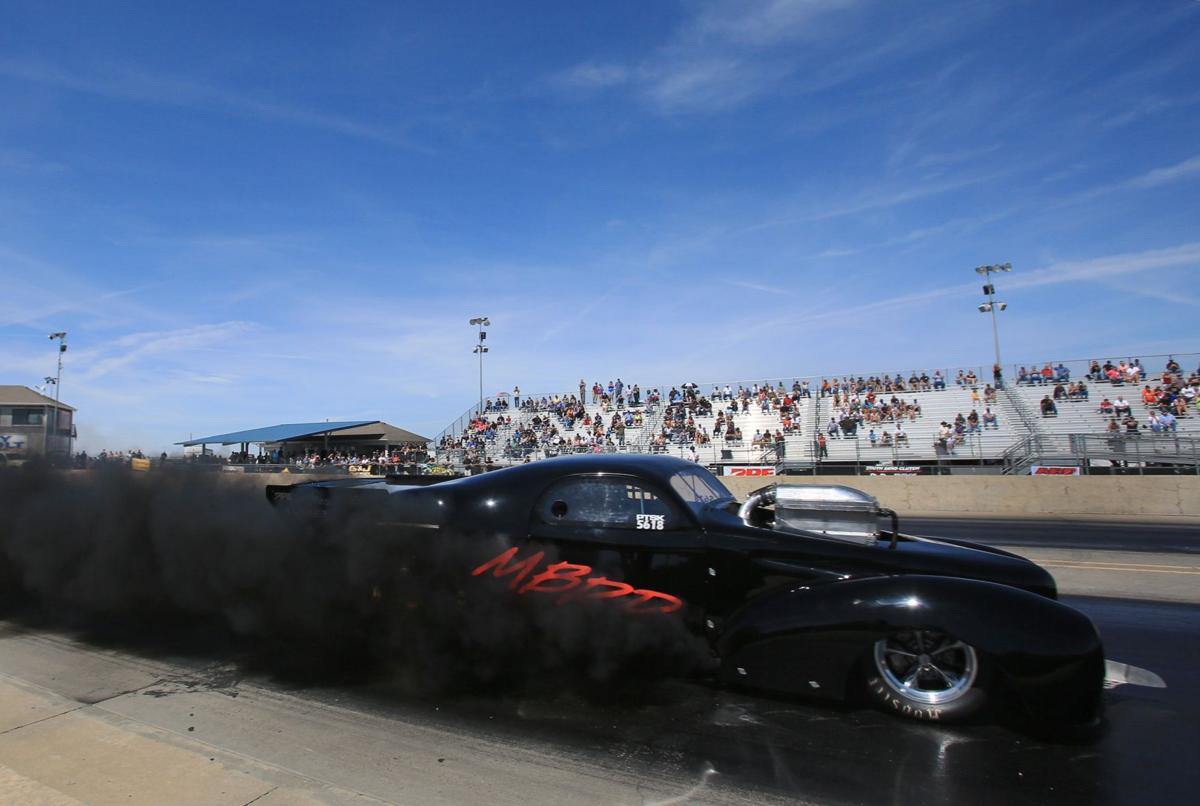 1941 Willys coupe speeds down the drag strip