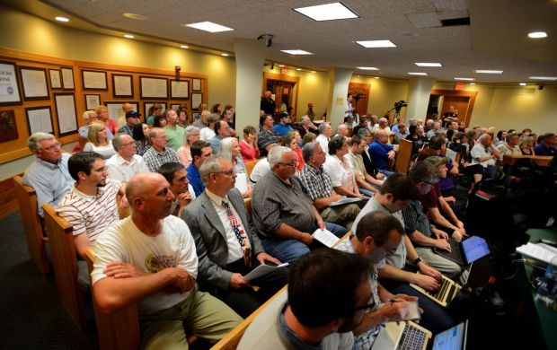 A packed city council meeting