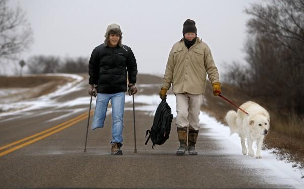 Del Kranzler walks Firdavs Temirov to the bus stop