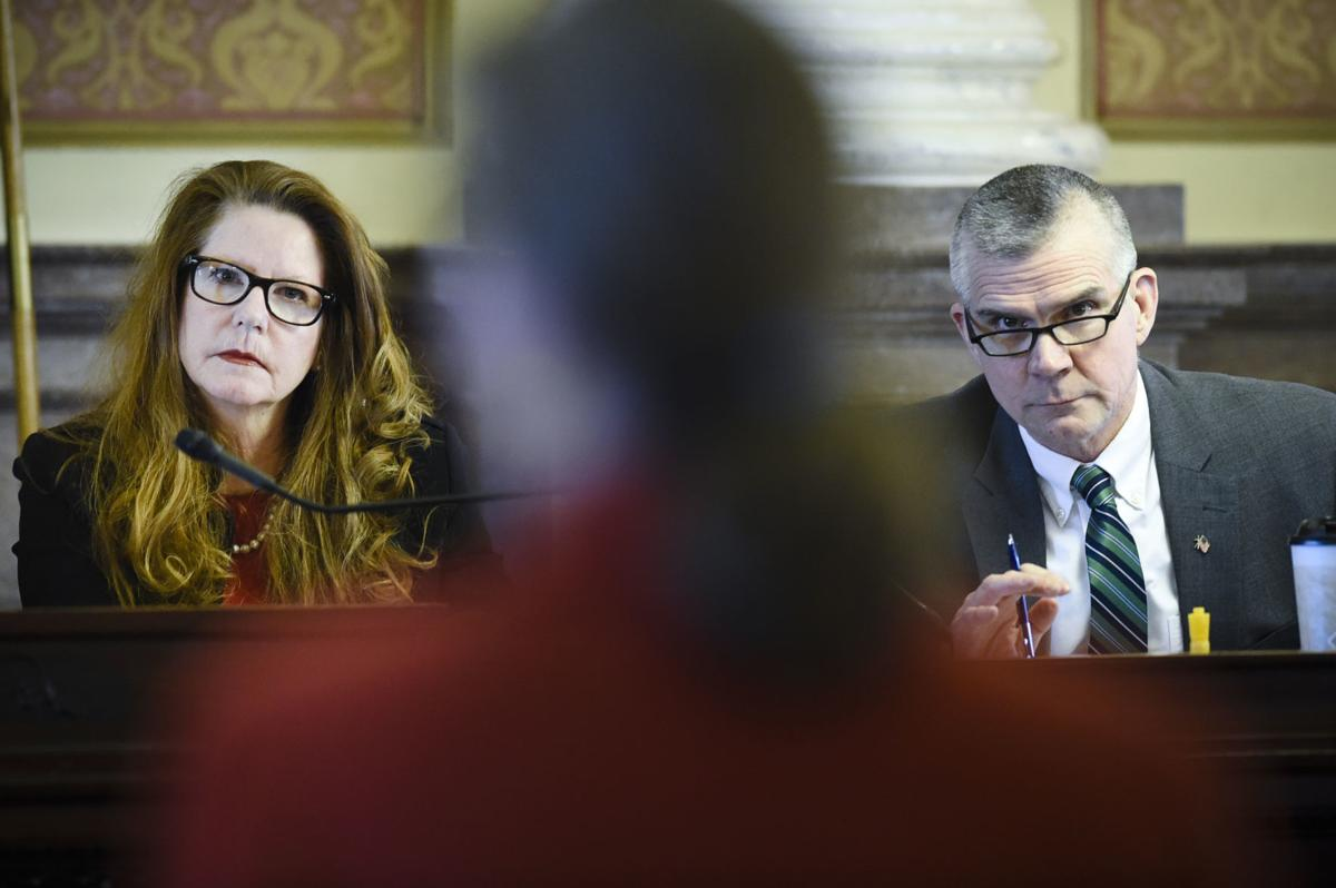 Superintendent of Public Instruction Elsie Arntzen, left, and State Auditor Matt Rosendale, right, listen to Director of Montana Fish, Wildlife and Parks Martha Williams answer a question