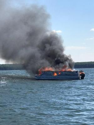 Pontoon erupts in flames; boats rush to rescue man, daughter and their dog
