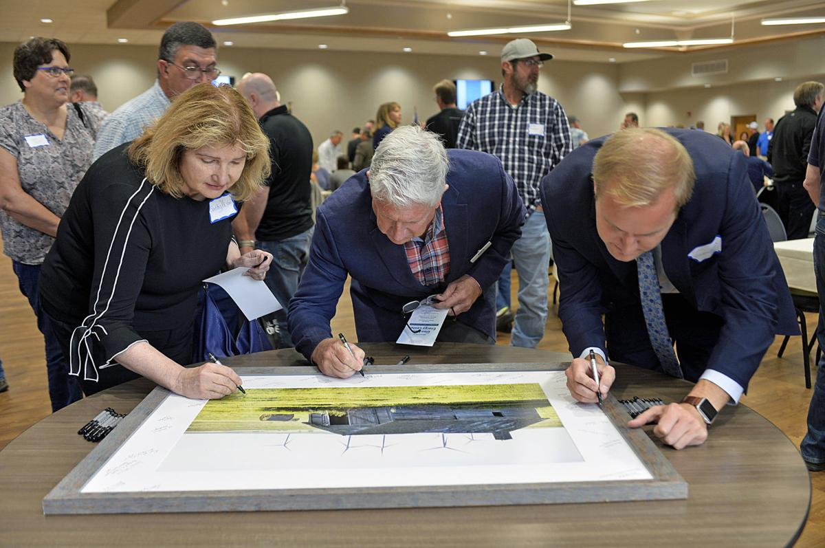 Allete wind dedication signing photo