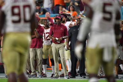 Head coach Willie Taggart of the Florida State Seminoles coaching in the second half against the Miami Hurricanes at Hard Rock Stadium on October 6, 2018 in Miami, Fla. (Mark Brown/Getty Images/TNS) **FOR USE WITH THIS STORY ONLY**