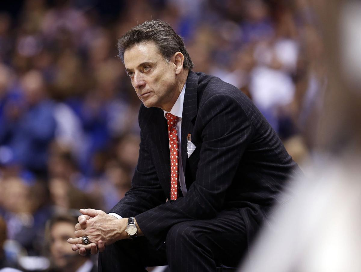 Louisville head coach Rick Pitino late in the second half of a 74-69 loss to Kentucky in the NCAA Tournament's Midwest Region semifinal at Lucas Oil Stadium in Indianapolis on March 28, 2014.