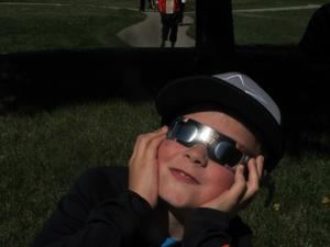 Families share the eclipse experience