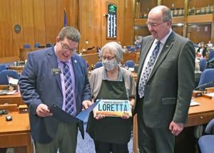 Lawmakers, governor honor longtime Capitol Cafe worker
