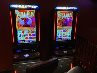 Electronic pull tab machines