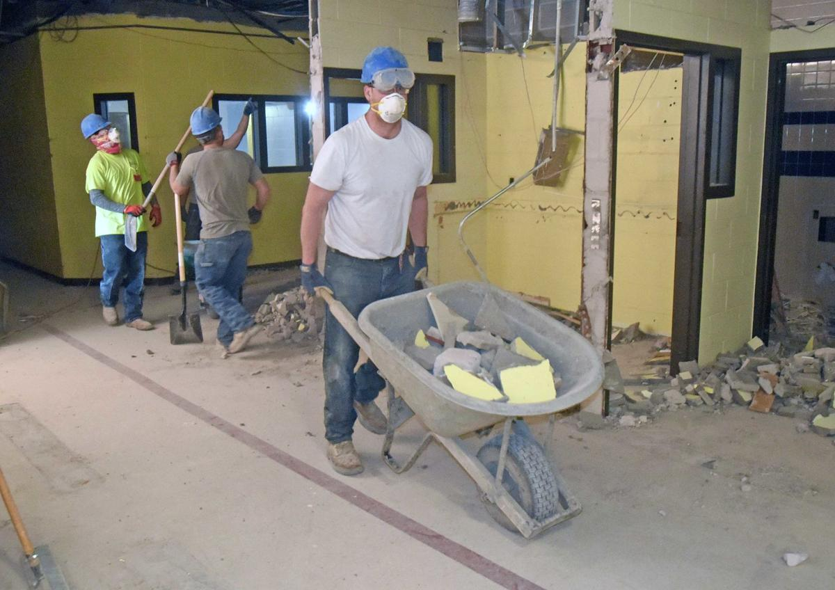 Asbestos removal, updated systems push up cost of former