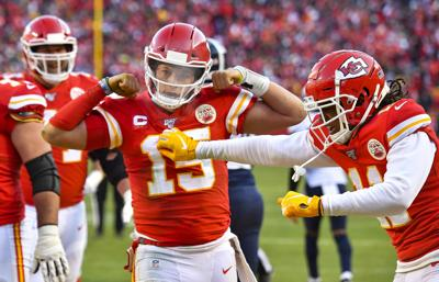 Kansas City Chiefs quarterback Patrick Mahomes (15) celebrates his 27-yard touchdown run late in the second quarter against the Tennessee Titans during the AFC championship game on January 19, 2020, at Arrowhead Stadium in Kansas City, Mo.