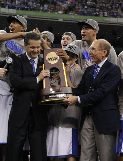 Kentucky head coach John Calipari and university president Eli Capilouto with the championship trophy after a 67-59 win against Kansas in the NCAA Tournament finals at the Mercedes-Benz Superdome in New Orleans on April 2, 2012.