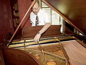 Governors' Mansion's battle-scared 1910 Steinway piano restored