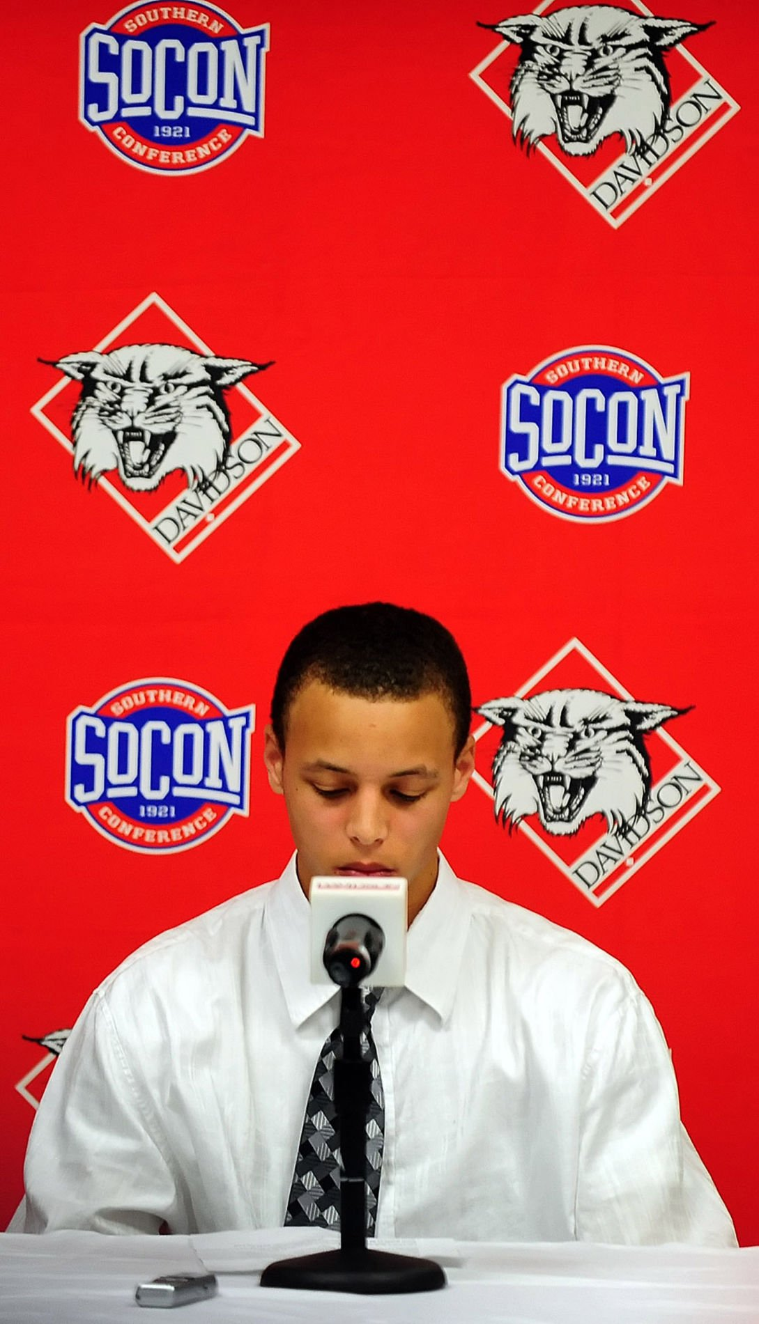 Davidson's Stephen Curry pauses during a news conference where he announced his intent to forego his senior year at Davidson College and enter the NBA draft in Davidson, N.C., on Thursday, April 23, 2009.