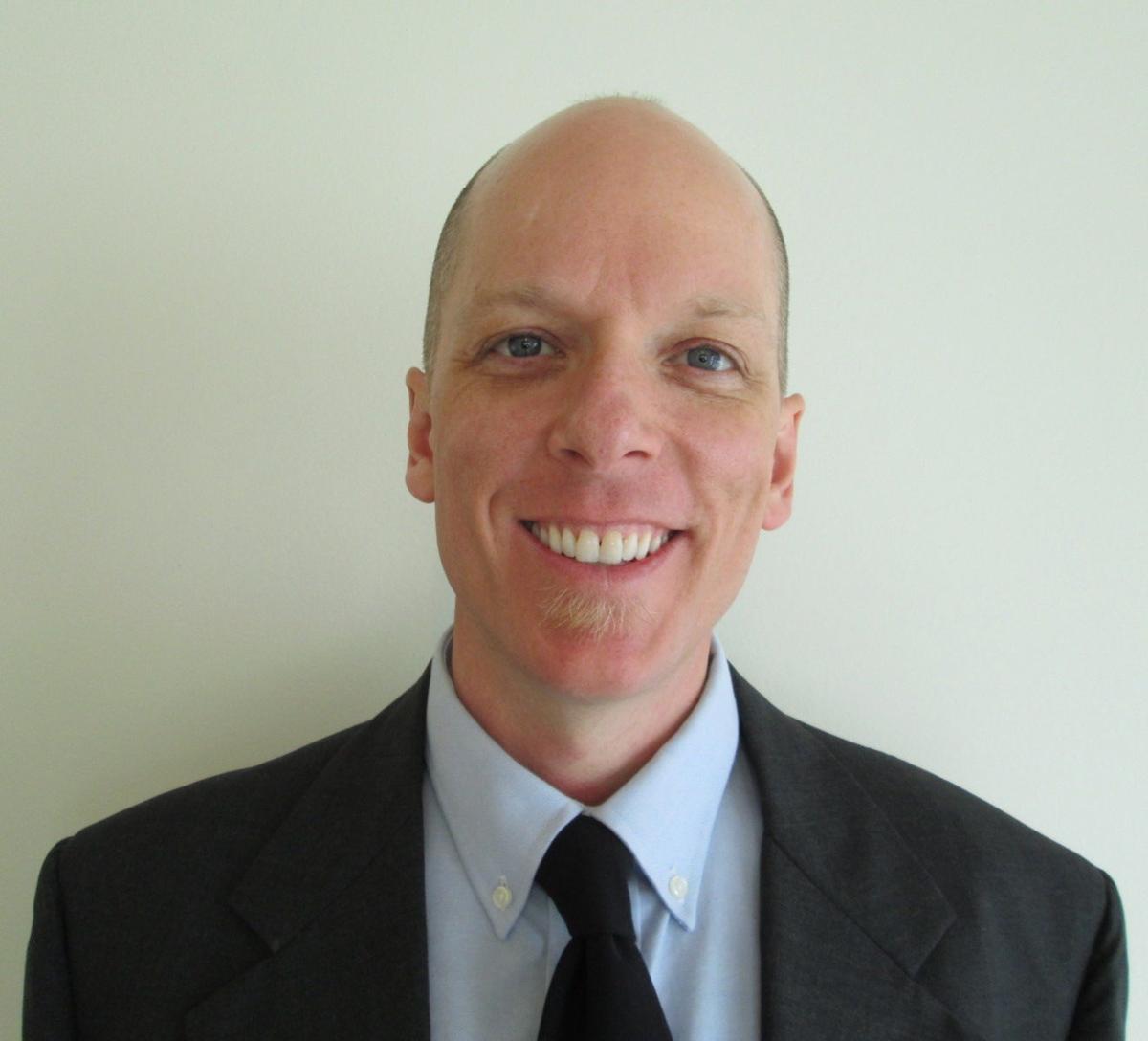 Dr. Eric D. Whitmont