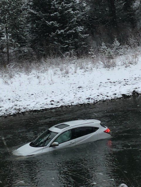 Car in Gallatin River