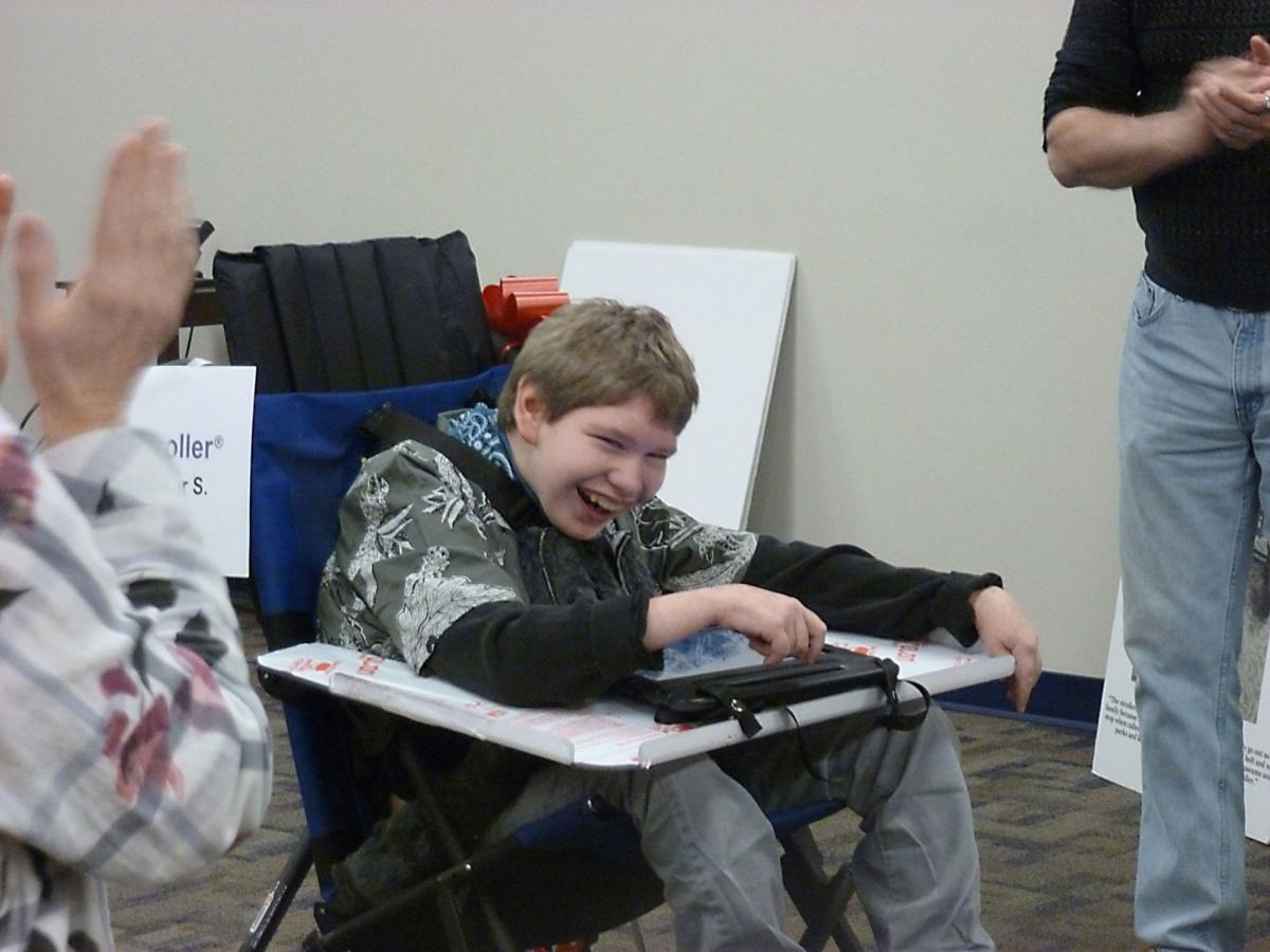 Variety gives adaptive equipment to local children