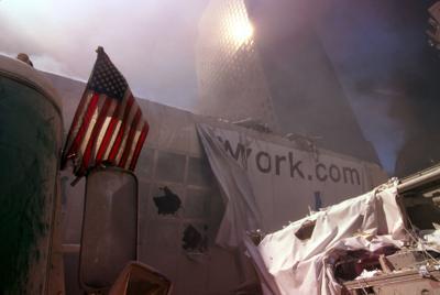 9-11 PHOTOS JASON American_flag_amid_rubble_following_September_11th_terrorist_attack_(29346763401).jpg