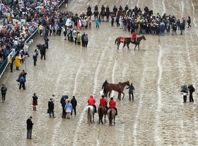 A view of Maximum Security and Country House both being hotwalked while awaiting the outcome of a protest after the 145th running of the Kentucky Derby at Churchill Downs in Louisville, Ky., on May 4, 2019. Country House was declared the winner after a stewards review disqualified Maximum Security. (Jamie Squire/Getty Images/TNS) **FOR USE WITH THIS STORY ONLY**