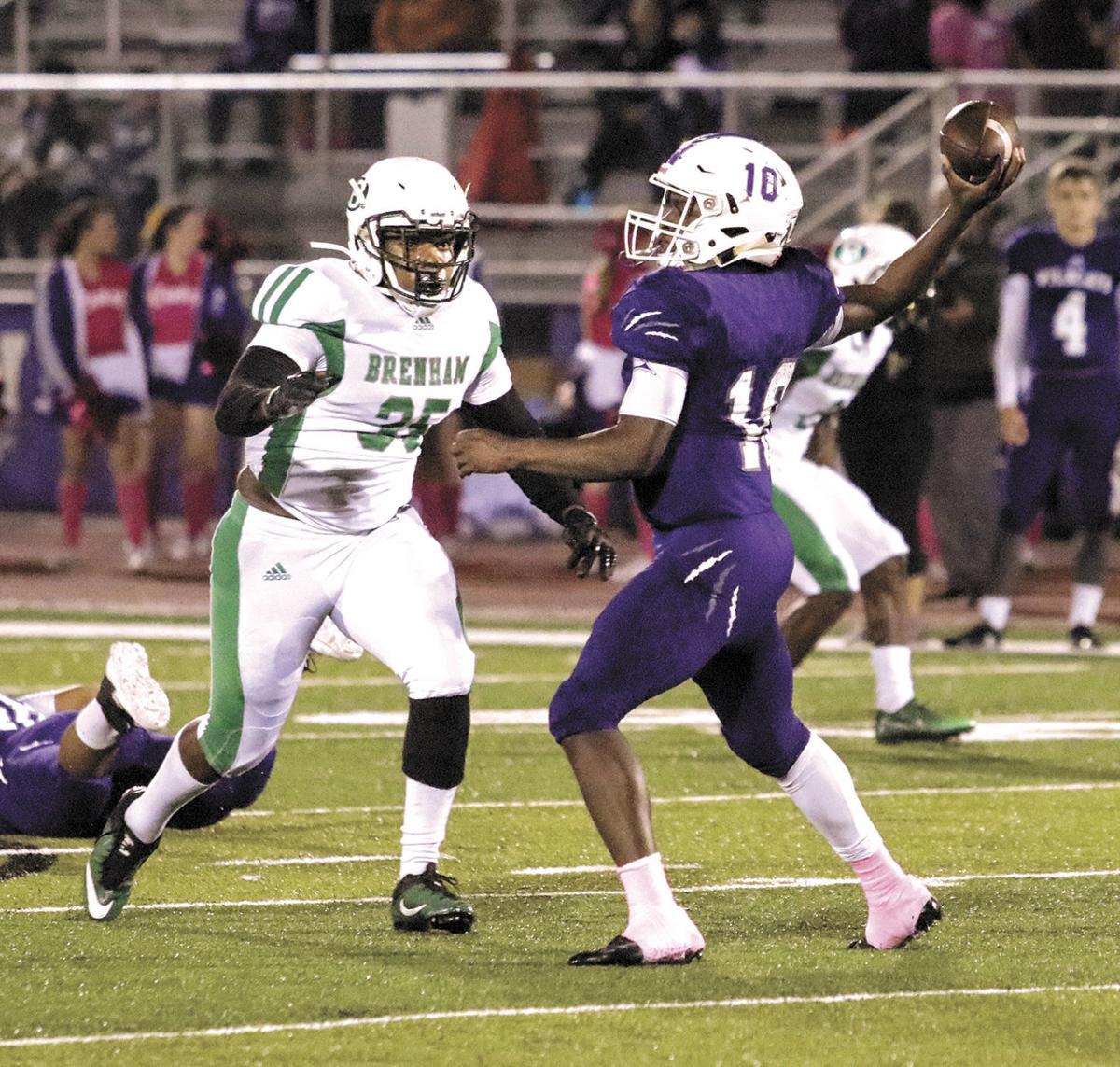 Brenham's Kelvin Mathis rushes the quarterback