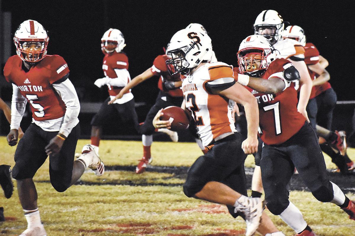 Burton's Cameron Riggins makes the tackle