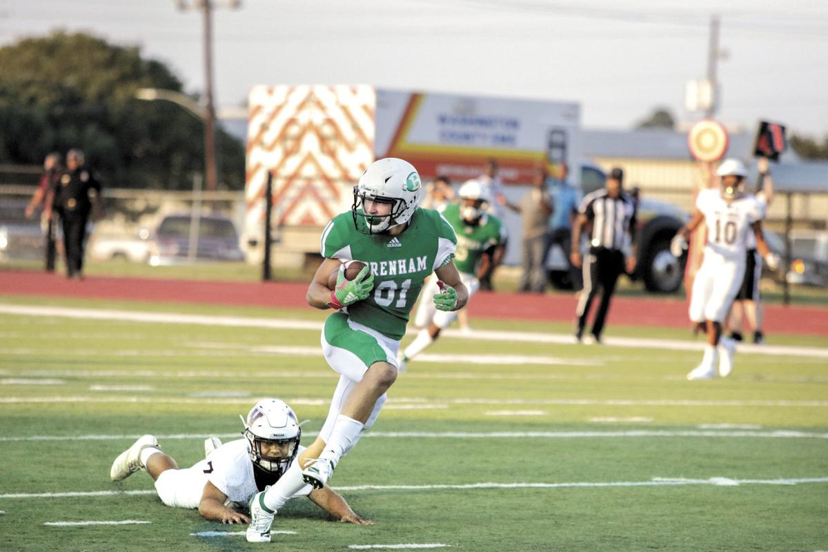 Brenham's Jackson Mueller opens the game with a touchdown