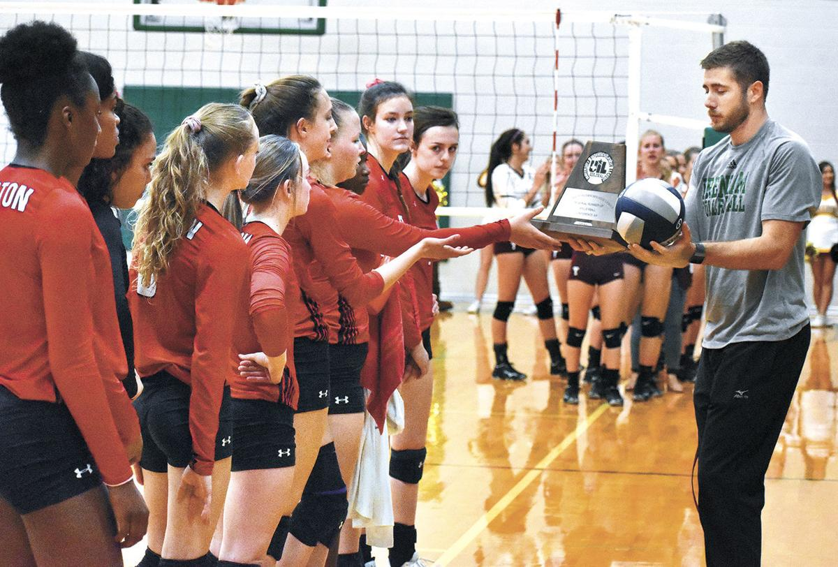 Burton Volleyball Receives Its Trophy