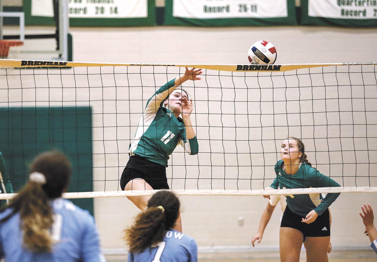 Brenham's Chloe Tanner gets it over the net