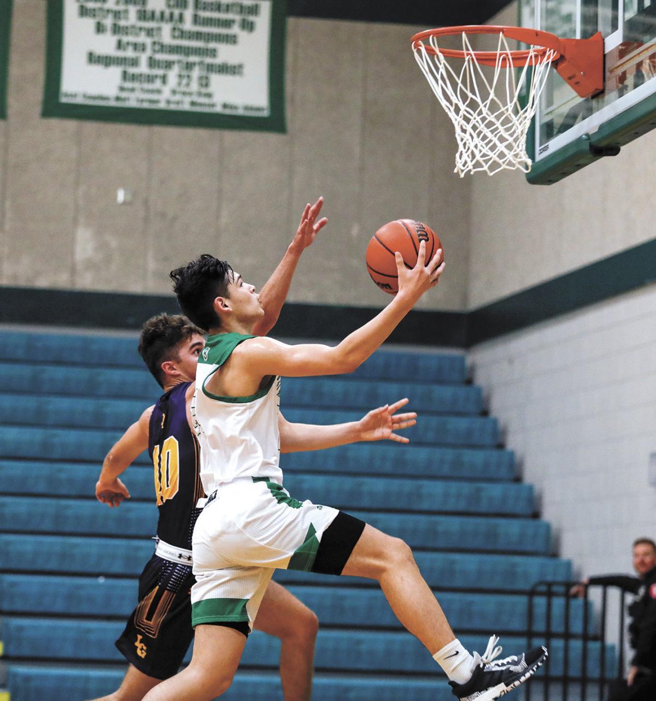 Brenham's Mauricio Chandler drives to the basket