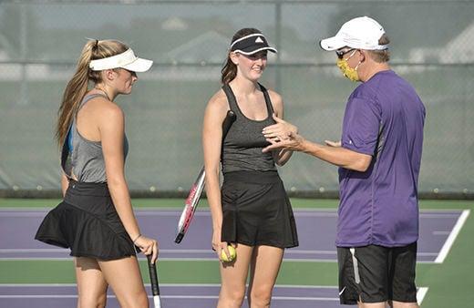 Bryan tennis coach Mitchell Owens teaches