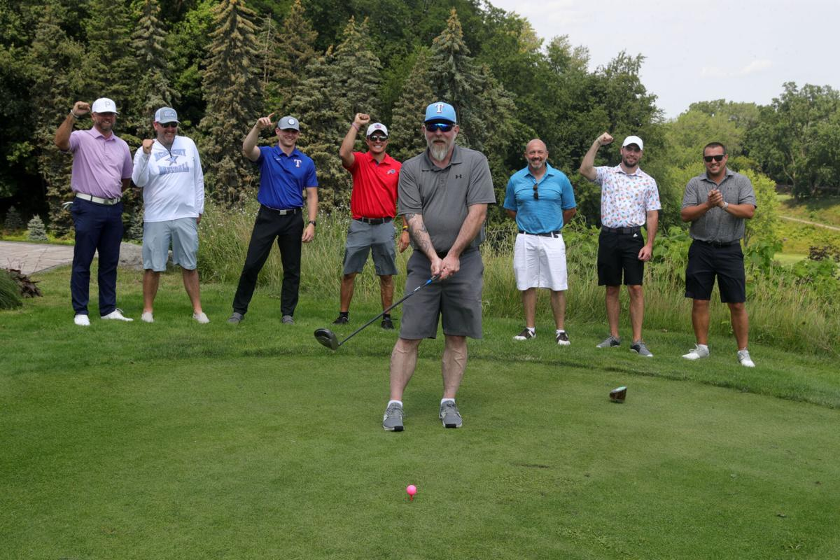 Jamie Heim takes his son Jonah's friends and coaches golfing