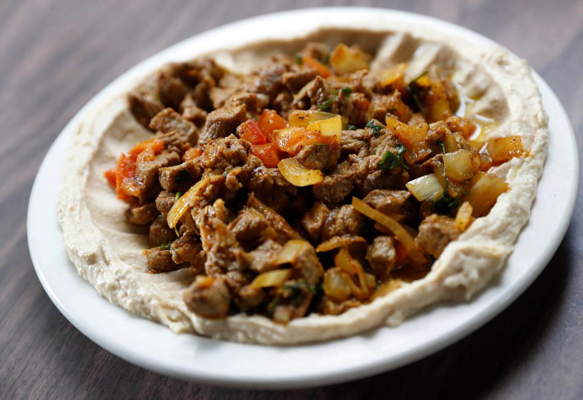 Lamb ghallaba over hummus at Crave King