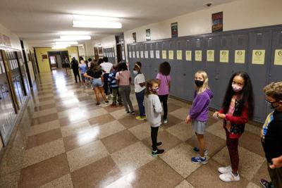 Joy, anxiety, raincoats and long lines on first day of school for many