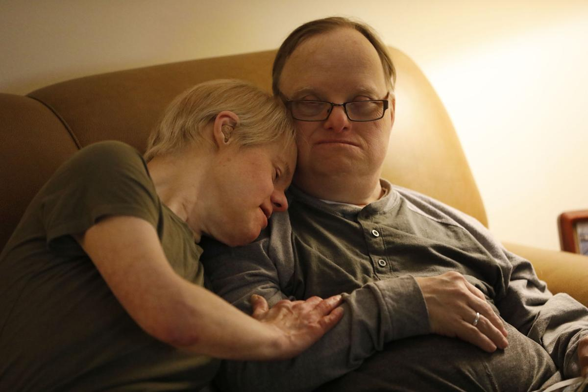 Paul Scharoun-DeForge and his wife Kris enjoy a moment at home on the couch.
