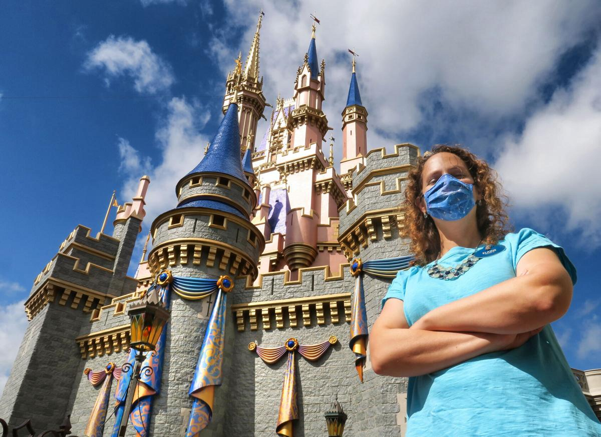 Disney senior project manager Elaine Schomburg-LaFleur at Cinderella Castle, adorned with the first decorations being installed for the Magic Kingdom's 50th Anniversary celebration later this year, at Walt Disney World, Lake Buena Vista, Fla., March 19, 2021.