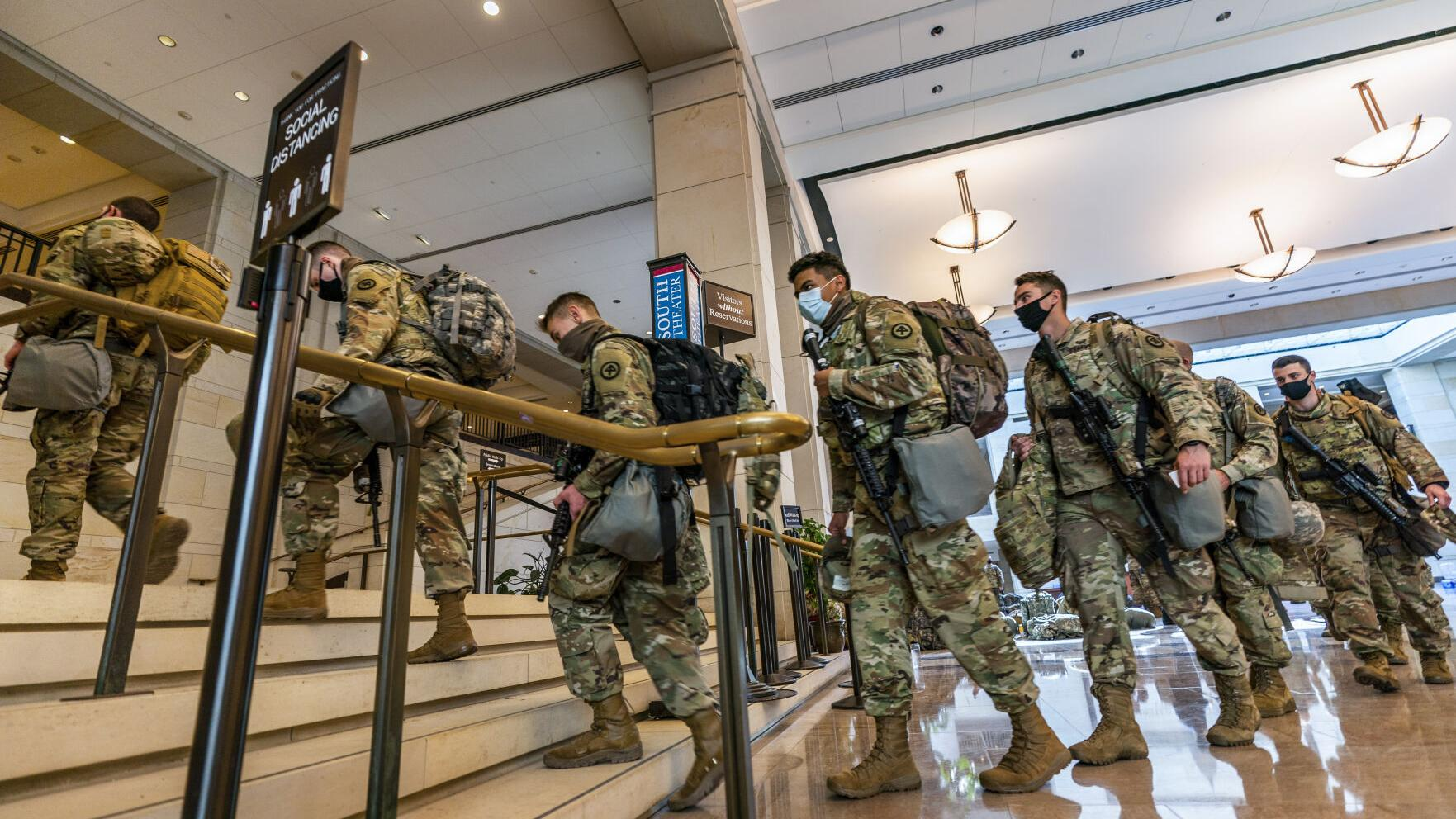 Impeachment scene: The graffiti is gone but troops fill Capitol hallways