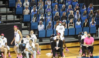Cutouts fill the seats