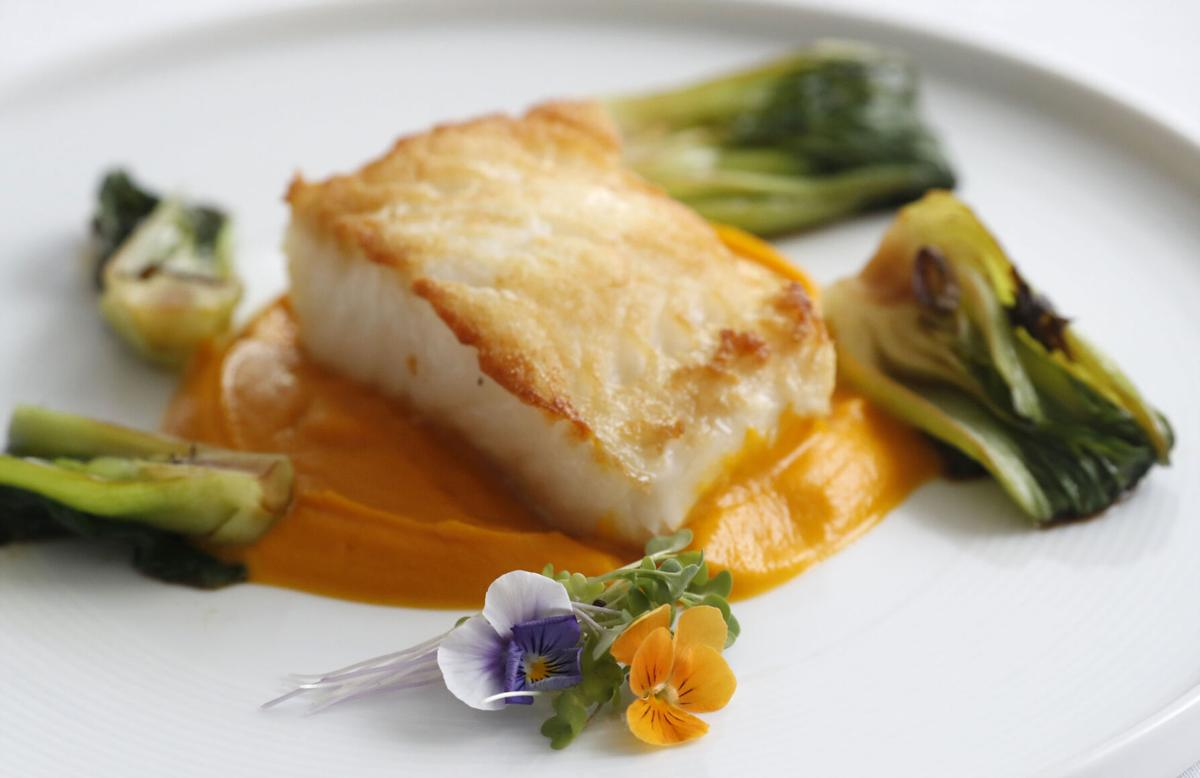 Seabass with carrot-ginger puree at Harvest in Medina