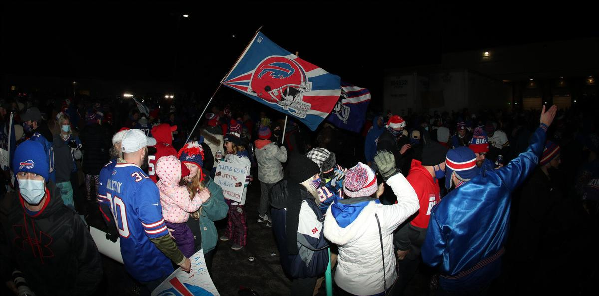 Thousands of adoring fans greeted the Bills at the airport after winning the AFC East title