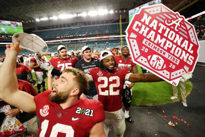 Najee Harris of the Alabama Crimson Tide celebrates following the College Football Playoff National Championship game win over the Ohio State Buckeyes at Hard Rock Stadium on Jan. 11, 2021 in Miami Gardens, Florida.
