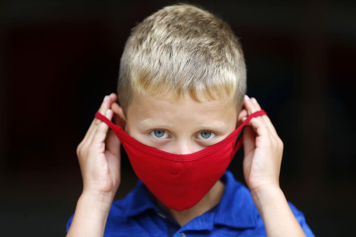 Children show off their face masks