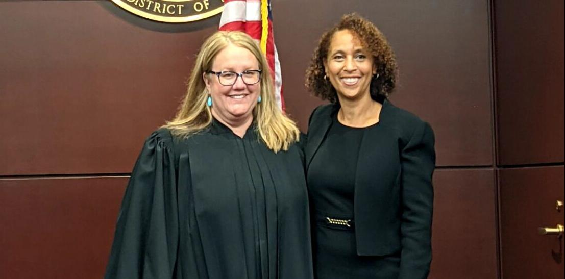 U.S. Chief Justice District Judge Elizabeth Wolford (left) swears in Trini E. Ross as U.S. Attorney for the Western District of New York on Monday