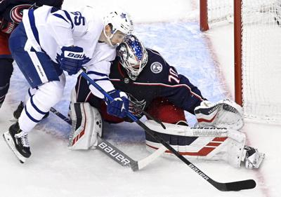 APTOPIX Blue Jackets Maple Leafs Hockey