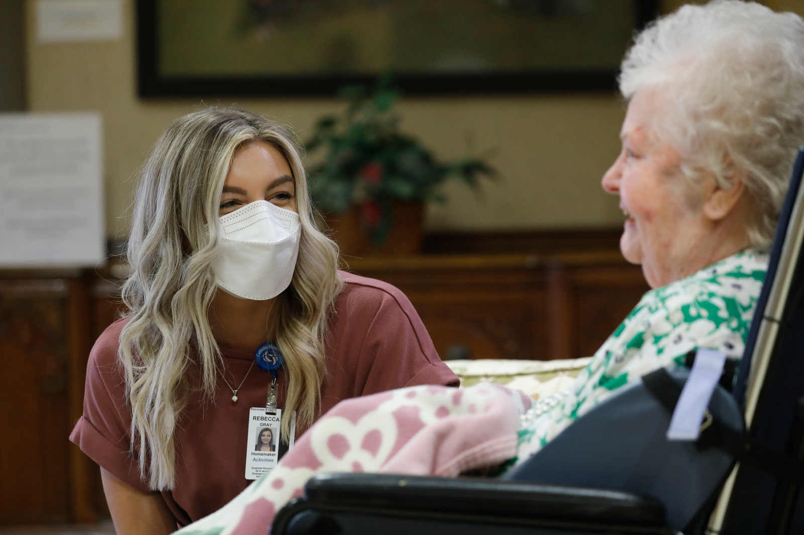 Worker meets with resident at nursing home.