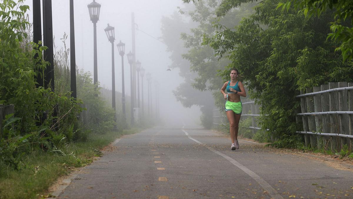 Manke jogs through fog on Shoreline Trail