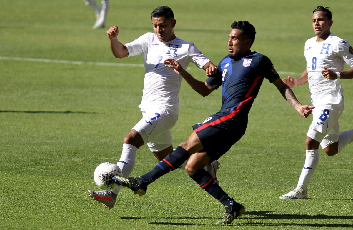 United States' Jesus Ferreira, right, and Honduras' Jose Reyes, left, vie for the ball during their CONCACAF Olympic Qualifying Semifinal football match at the Jalisco Stadium in Guadalajara, Mexico, on March 28, 2021.