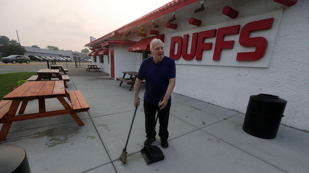 Ron Duff cleans patio at Duff's