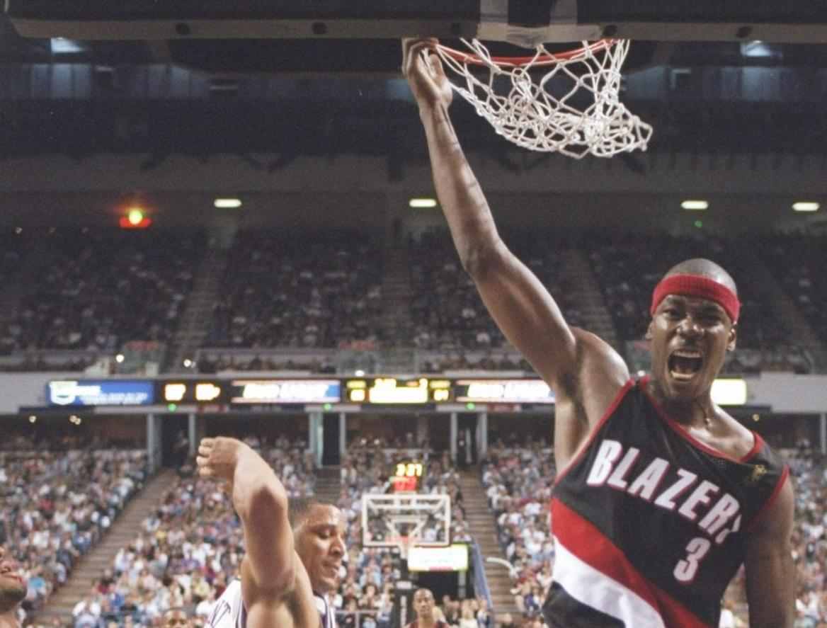 NBA player Cliff Robinson with Blazers uniform, grabbing rim