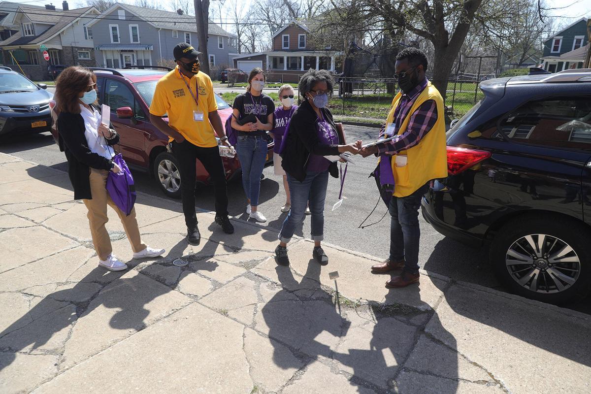 Volunteers prepare to go door-to-door