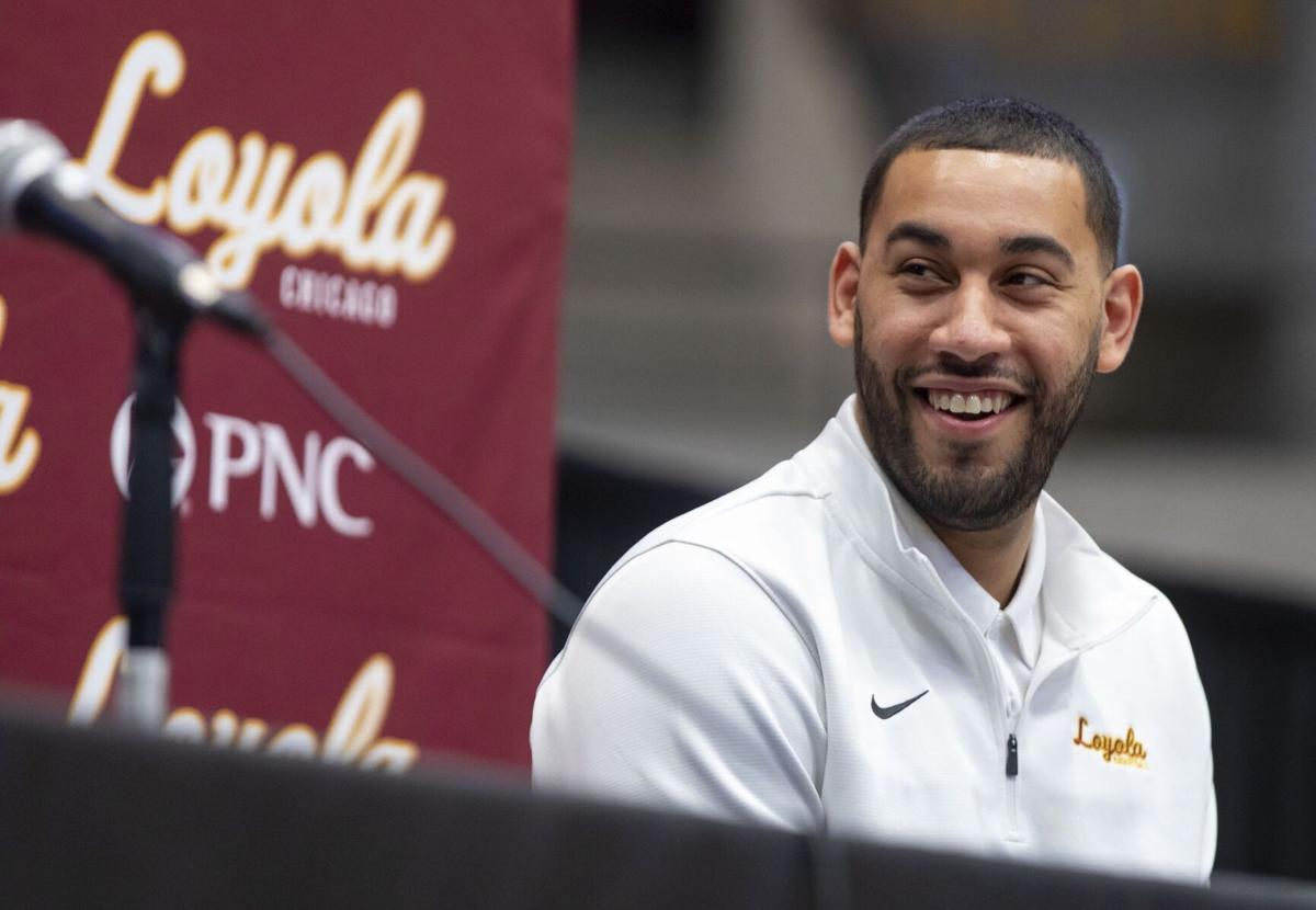 Former Loyola assistant men's basketball coach Drew Valentine, who will succeed Porter Moser, appears at his introductory press conference on April 6, 2021.